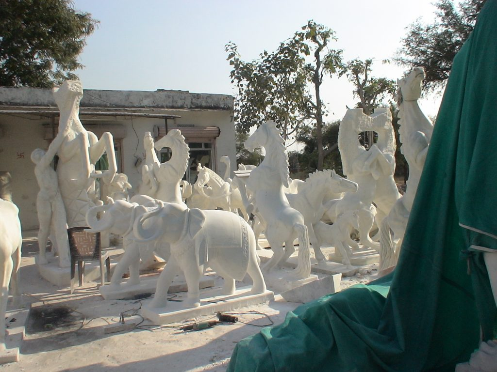Road side Marble sculptures Industry.  This is common site in Rajestan rural areas.